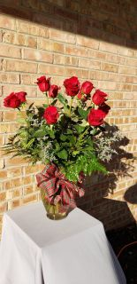1 doz red roses holiday greens